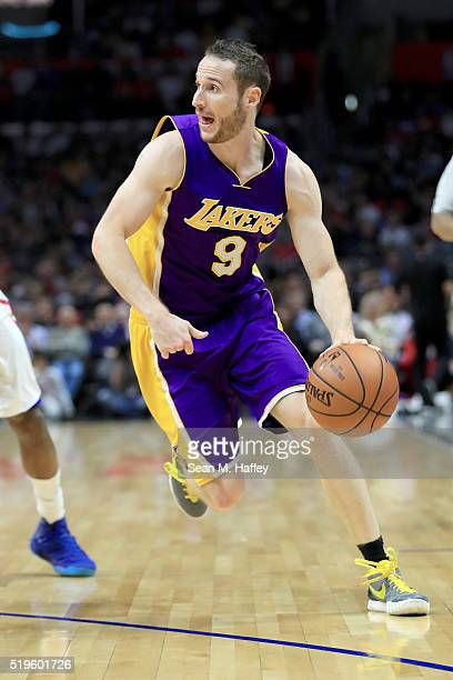 Marcelo Huertas of the Los Angeles Lakers dribbles upcourt during an NBA game between Los Angeles Clippers vs Los Angeles Lakers April 5 2016 at...