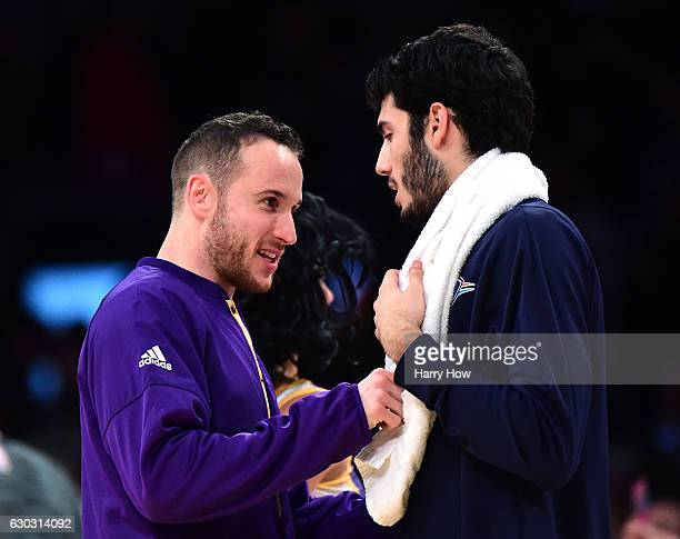 Marcelo Huertas of the Los Angeles Lakers shakes hands with Enes Kanter of the Oklahoma City Thunder at the end of the game at Staples Center on...