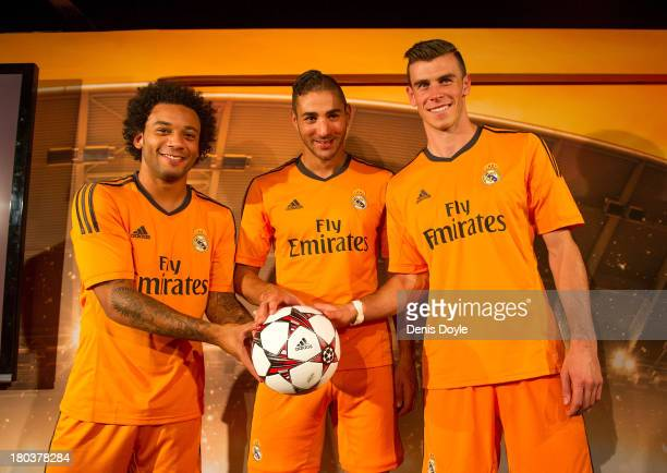 Marcelo Karim Benzema and Gareth Bale of Real Madrid present their team's UEFA Champions League kit at the Torre Europa building on September 12,...