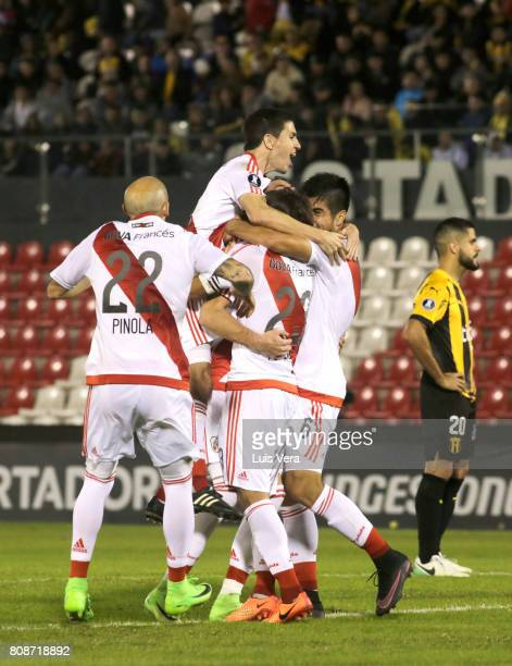Marcelo Larrondo of River Plate celebrates with teammates after scoring his tea'ms second goal during a first leg match between Guarani and River...
