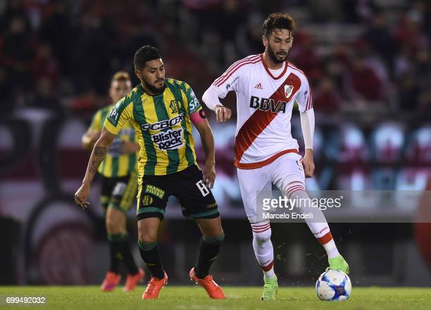 Marcelo Larrondo of River Plate fights for ball with Alan Alegre of Aldosivi during a match between River Plate and Aldosivi as part of Torneo...
