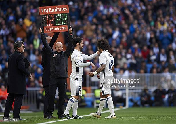 Marcelo leaves the pith injured during the La Liga match between Real Madrid CF and Malaga CF at Estadio Santiago Bernabeu on January 21 2017 in...