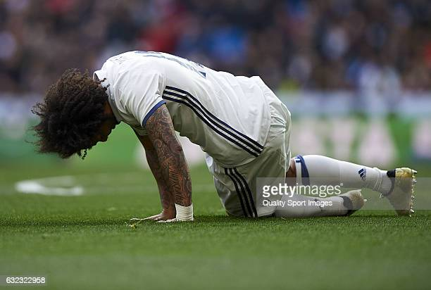 Marcelo lies on the pith injured during the La Liga match between Real Madrid CF and Malaga CF at Estadio Santiago Bernabeu on January 21 2017 in...