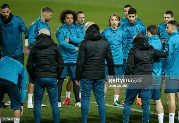 Marcelo Luka Modric of Real Madrid and teammates listen to coach of Real Madrid Zinedine Zidane during Real Madrid's training on the eve of UEFA...