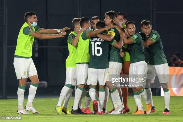 Marcelo Martins of Bolivia celebrates with teammates after scoring the first goal of his team during a match between Paraguay and Bolivia as part of...