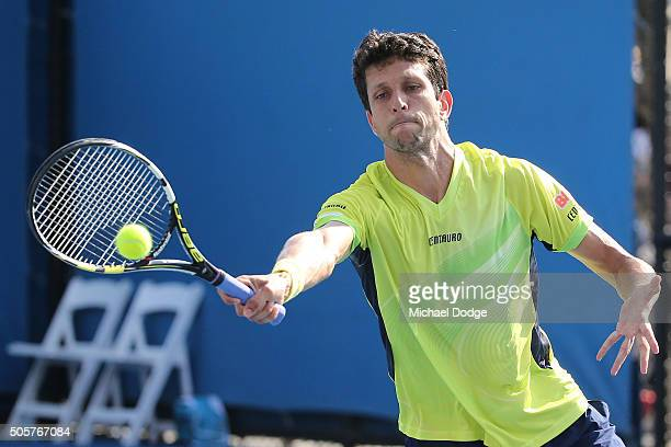 Marcelo Melo of Brazi plays a forehand in his first round doubles match with Ivan Dodig of Croatia against Aljaz Bedene and Dustin Brown of Germany...