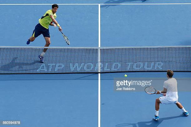 Marcelo Melo of Brazil and Ivan Dodig of Croatia play against Daniel Nestor and Vasek Pospisil of Canada during their semifinal doubles match on Day...