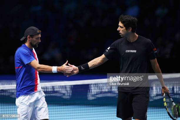 Marcelo Melo of Brazil and Lukasz Kubot of Poland celebrate after winning the Doubles Semi Final match against Ryan Harrison of the United States and...