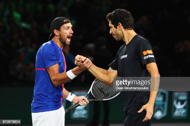Marcelo Melo of Brazil and Lukasz Kubot of Poland celebrate match point winning the Mens Doubles Final against Marcel Granollers of Spain and Ivan...