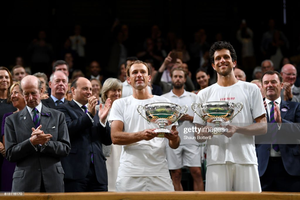 Marcelo Melo of Brazil (R) and Lukasz Kubot of Poland celebrate victory with their trophies after the Gentlemen's Doubles final against Oliver Marach of Austria and Mate Pavic of Croatia on day twelve of the Wimbledon Lawn Tennis Championships at the All England Lawn Tennis and Croquet Club at Wimbledon on July 15, 2017 in London, England.