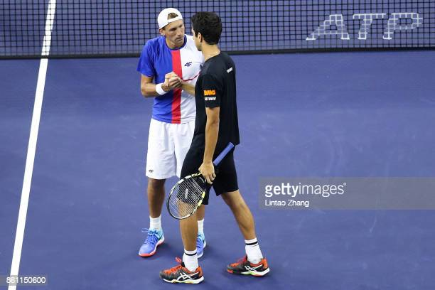 Marcelo Melo of Brazil and Lukasz Kubot of Poland celebrates after winning the Men's Doubles Semifinal mach against JeanJulien Rojer of Netherland...