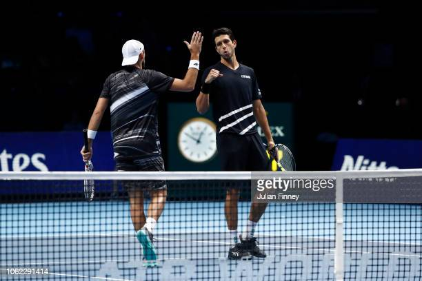 Marcelo Melo of Brazil and Lukasz Kubot of Poland celebrates during their round robin match against Oliver Marach of Austria and Mate Pavic of...