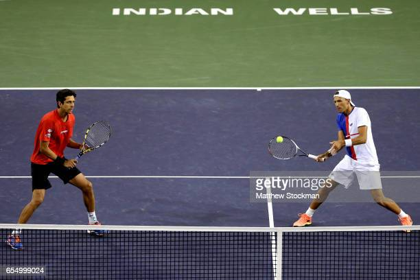 Marcelo Melo of Brazil and Lukasz Kubot of Poland play Raven Klassen and Rajeev Ram in the men's doubles final during the BNP Paribas Open at the...