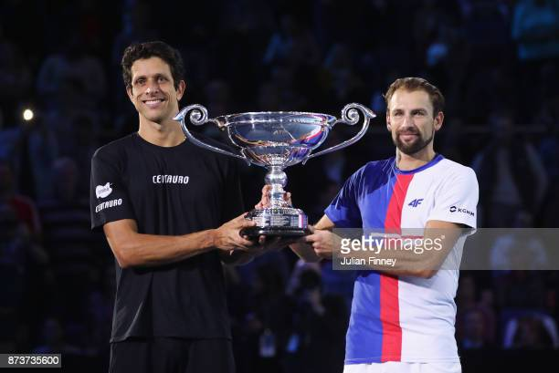 Marcelo Melo of Brazil and Lukasz Kubot of Poland pose with the ATP World Tour No1 Doubles Team trophy presented by Emirates after defeating Ivan...