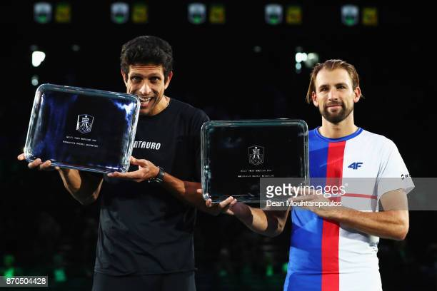 Marcelo Melo of Brazil and Lukasz Kubot of Poland pose with their winners trophy after winning the Mens Doubles Final against Marcel Granollers of...