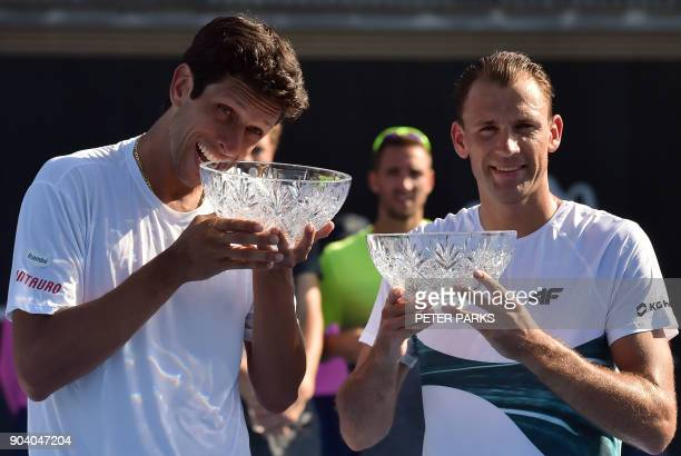 Marcelo Melo of Brazil and Lukasz Kubot of Poland pose with their winning trophy in their men's doublesfinal against JanLennard Struff of Germany and...
