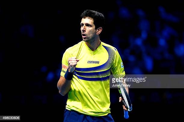 Marcelo Melo of Brazil celebrates a point during the men's doubles match against Marcin Matlowski of Poland and Nenad Zimonjic of Serbia on day six...