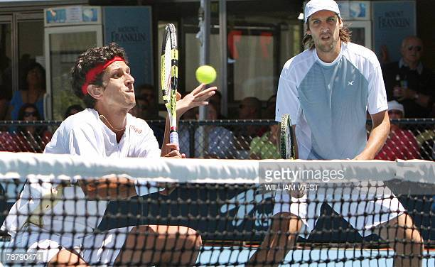 Marcelo Melo of Brazil hits a return as partner Martin Garcia of Argentina looks on during the doubles final of the Australian men's hardcourt tennis...