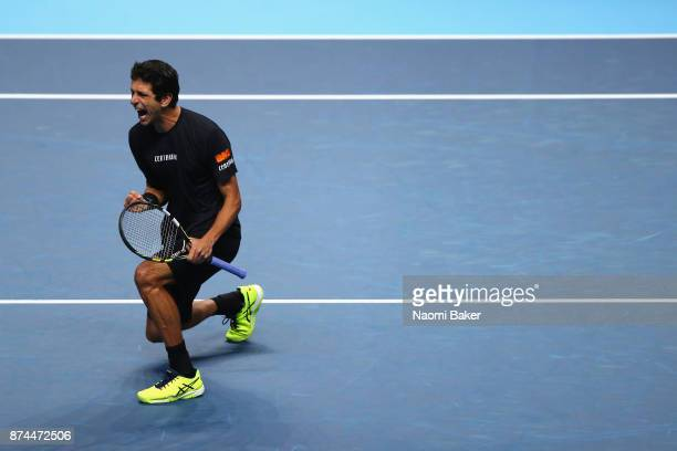 Marcelo Melo of Brazil partner of Lukasz Kubot of Poland celebrates a point during the doubles match against Bob Bryan of The United States and Mike...