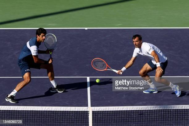 Marcelo Melo of Brazil play Ivan Dodig of Croatia play Sander Gille and Joran Vliegen of Belgium during the BNP Paribas Open at the Indian Wells...