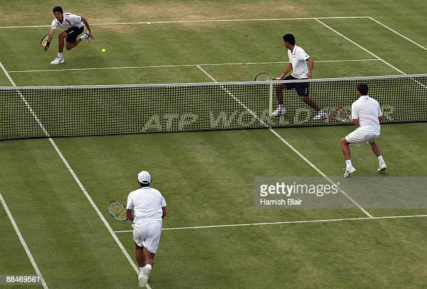 Marcelo Melo of Brazil plays a forehand playing with Andre Sa of Brazil during the men's doubles semi final match against Jeff Coetzee of South...