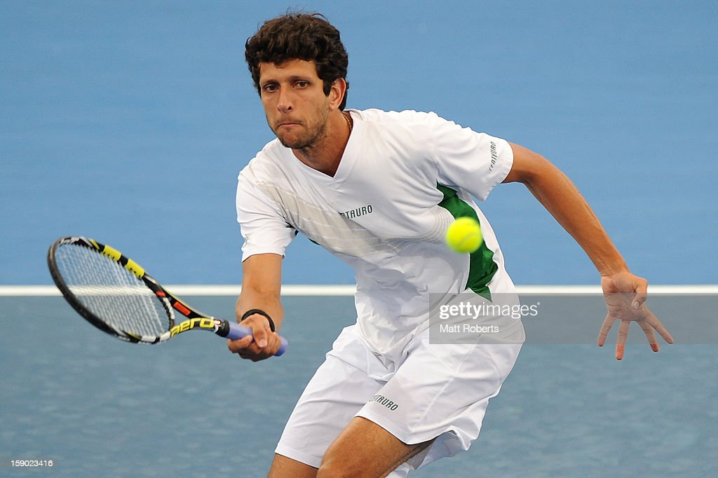 Marcelo Melo plays a forehand during his final partnered with Tommy Robredo against Eric Butorac and Paul Hanley on day eight of the Brisbane International at Pat Rafter Arena on January 6, 2013 in Brisbane, Australia.