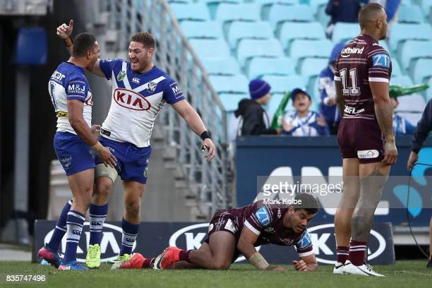 Marcelo Montoya and Brenko Lee of the Bulldogs celebrate Lee scoring a try during the round 24 NRL match between the Canterbury Bulldogs and the...