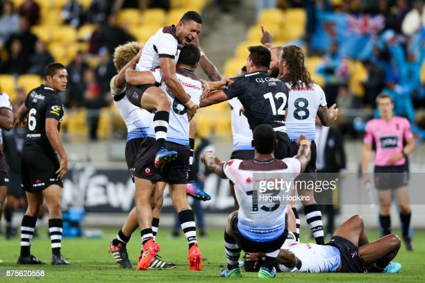 Marcelo Montoya and Jarryd Hayne of Fiji celebrate the win at the final whistle during the 2017 Rugby League World Cup Quarter Final match between...