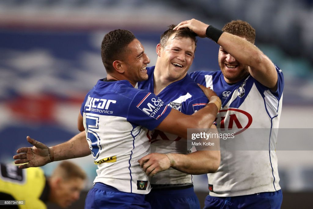 Marcelo Montoya, Brett Morris and Brenko Lee of the Bulldogs celebrate Brett Morris scoring a try during the round 24 NRL match between the Canterbury Bulldogs and the Manly Sea Eagles at ANZ Stadium on August 20, 2017 in Sydney, Australia.