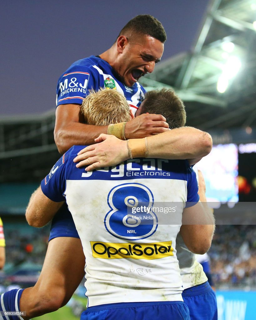Marcelo Montoya of the Bulldogs celebrates a try by Josh Morris during the round seven NRL match between the Canterbury Bulldogs and the South Sydney Rabbitohs at ANZ Stadium on April 14, 2017 in Sydney, Australia.