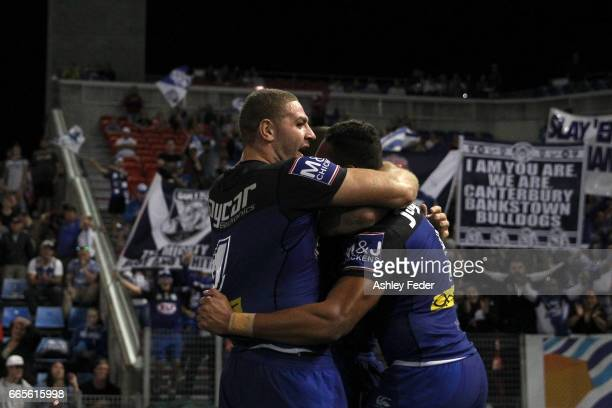 Marcelo Montoya of the Bulldogs celebrates his try during the round six NRL match between the Newcastle Knights and the Canterbury Bulldogs at...