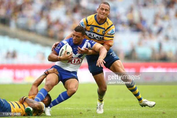 Marcelo Montoya of the Bulldogs is tackled by Kane Evans of the Eels during the round two NRL match between the Canterbury Bulldogs and the...