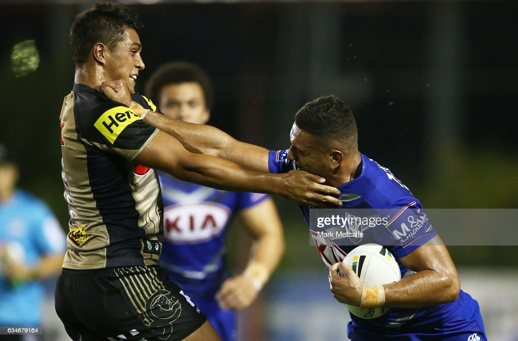 Marcelo Montoya of the Bulldogs is tackled by Te Maire Martin of the Panthers during the NRL Trial match between the Canterbury Bulldogs and the Penrith Panthers at Belmore Sports Ground on February 11, 2017 in Sydney, Australia.