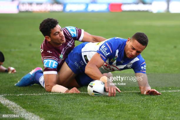 Marcelo Montoya of the Bulldogs scores a try during the round 24 NRL match between the Canterbury Bulldogs and the Manly Sea Eagles at ANZ Stadium on...