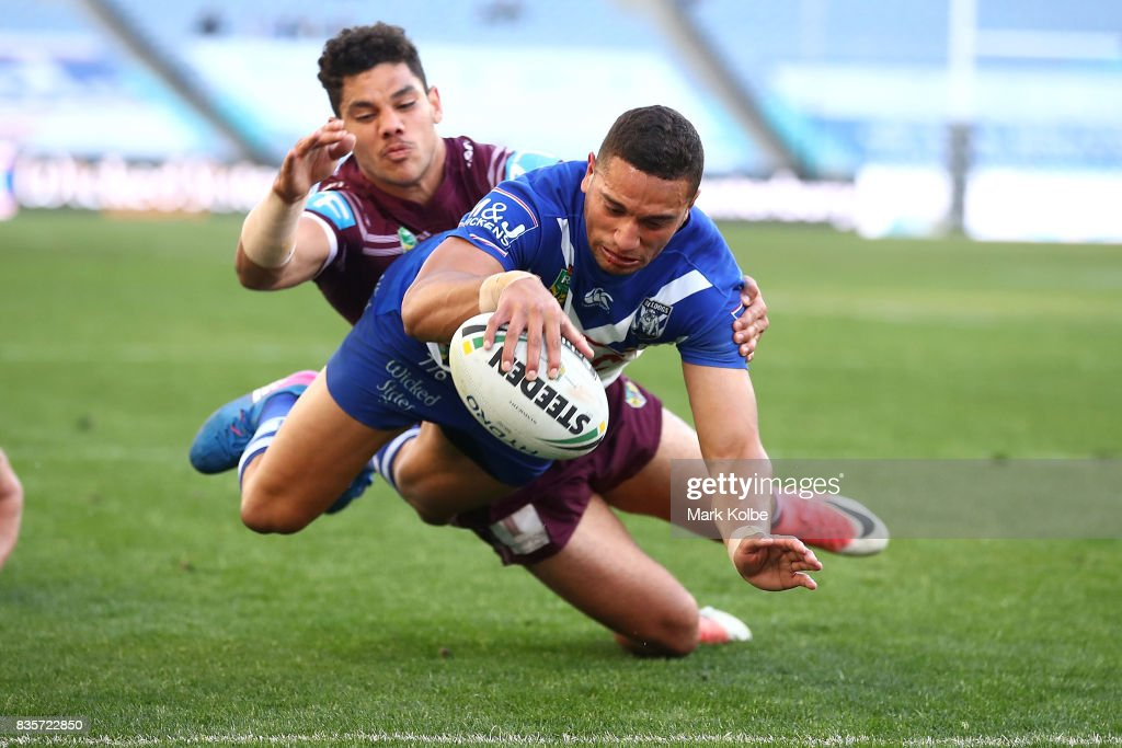 Marcelo Montoya of the Bulldogs scores a try during the round 24 NRL match between the Canterbury Bulldogs and the Manly Sea Eagles at ANZ Stadium on August 20, 2017 in Sydney, Australia.