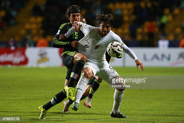 Marcelo Moreno Martins of Bolivia fights for the ball with Gerardo Flores of Mexico during the 2015 Copa America Chile Group A match between Mexico...