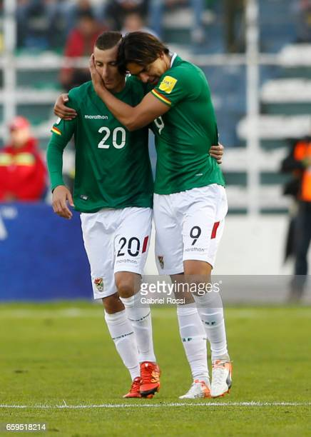 Marcelo Moreno of Bolivia celebrates with teammate Pablo Escobar after scoring the second goal of his team during a match between Bolivia and...