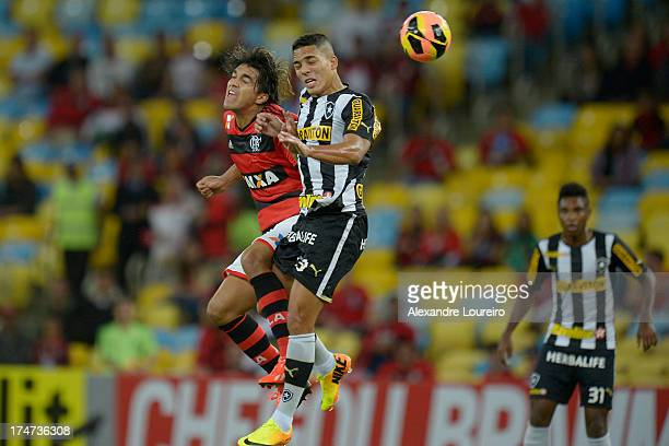 Marcelo Moreno of Flamengo fights for the ball with Gilberto of Botafogo during the match between Flamengo and Botafogo as part of the Brazilian...