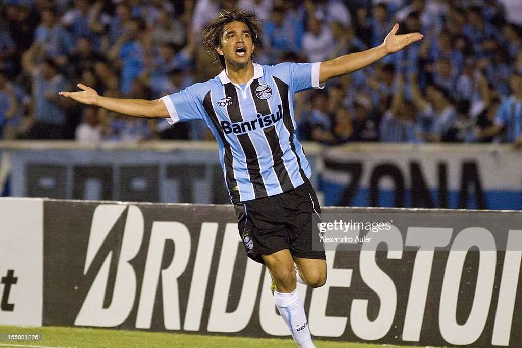 Marcelo Moreno of Grêmio celebrates a goal by marco Antonio during the match between Grêmio (Brazil) and Millonarios (Colombia) as part of the eighth stage of Copa Sudamericana 2012 at Olímpico stadium on October 30, 2012 in Porto Alegre, Brazil.