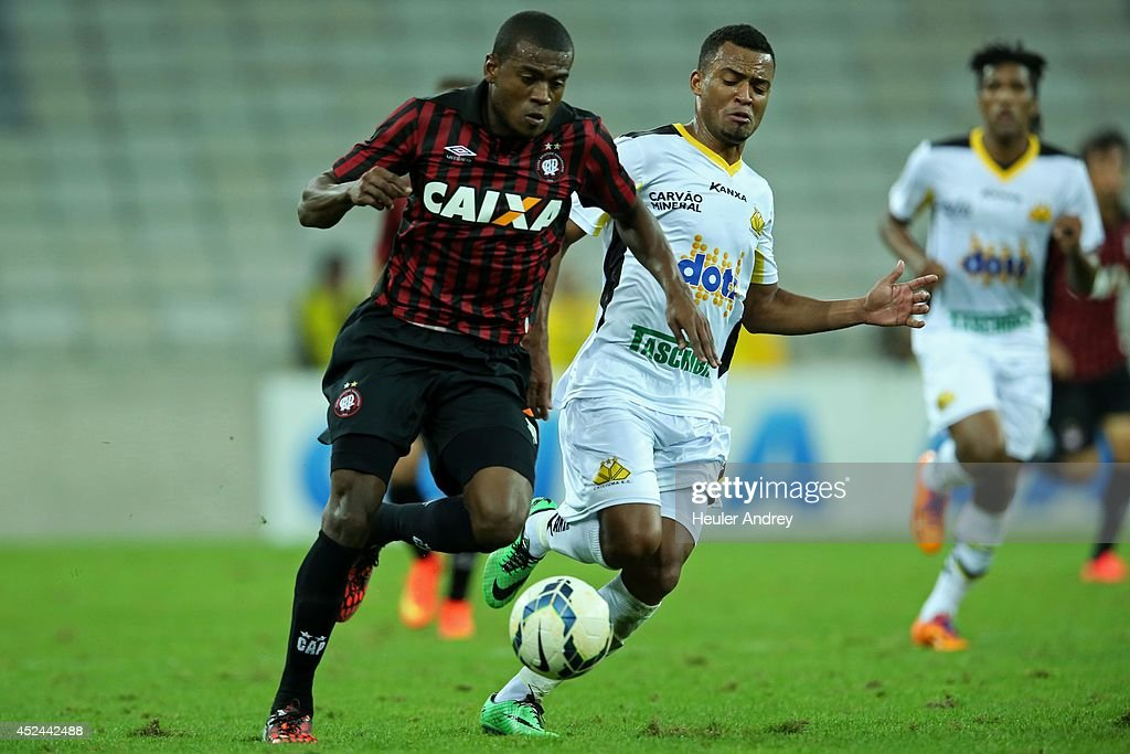 Marcelo of Atletico-PR competes for the ball with Joao Vitor of Criciuma during the match between Atletico-PR and Criciuma for the Brazilian Series A 2014 at Arena da Baixada on July 20, 2014 in Curitiba, Brazil.