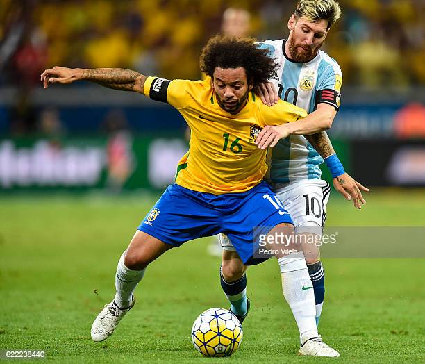 Marcelo of Brazil and Messi of Argentina battle for the ball during a match between Brazil and Argentina as part 2018 FIFA World Cup Russia Qualifier...