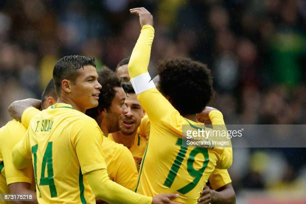 Marcelo of Brazil celebrates 02 with Jemerson of Brazil Thiago Silva of Brazil Giuliano of Brazil Willian of Brazil during the International Friendly...