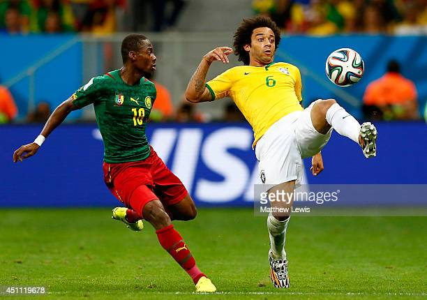 Marcelo of Brazil controls the ball against Enoh Eyong of Cameroon during the 2014 FIFA World Cup Brazil Group A match between Cameroon and Brazil at...