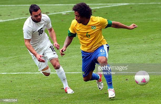 Marcelo of Brazil holds off Dakota Lucas of New Zealand during the Men's Football first round Group C match between Brazil and New Zealand on Day 5...