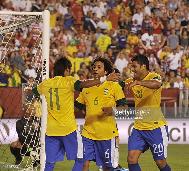 Marcelo of Brazil is congratulated by teammates during an international friendly with the US at FedEx Field in Landover, Maryland, on May 30, 2012....
