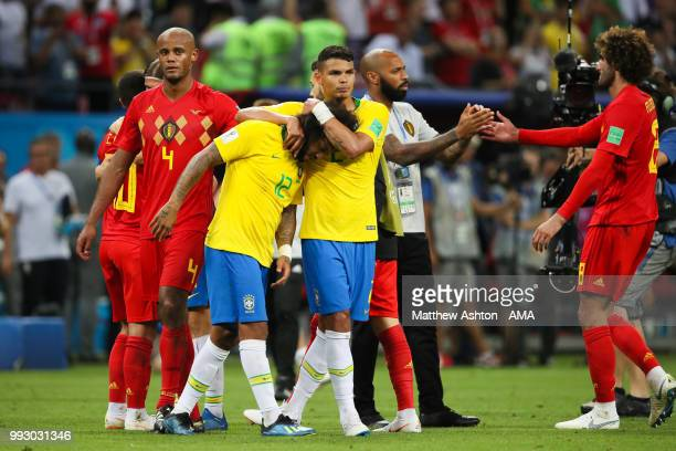 Marcelo of Brazil is consoled by Thiago Silva of Brazil at the end of the 2018 FIFA World Cup Russia Quarter Final match between Brazil and Belgium...