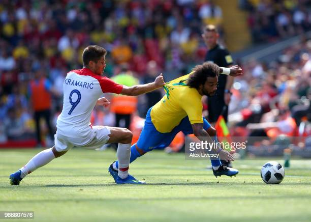 Marcelo of Brazil is fouled by Andrej Kramaric of Croatia during the International Friendly match between Croatia and Brazil at Anfield on June 3...