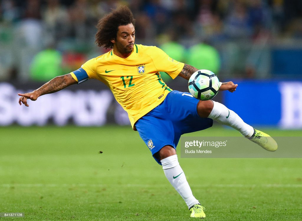 Marcelo of Brazil kicks the ball with of Ecuador during a match between Brazil and Ecuador as part of 2018 FIFA World Cup Russia Qualifier at Arena do Gremio on August 31, 2017 in Porto Alegre, Brazil.