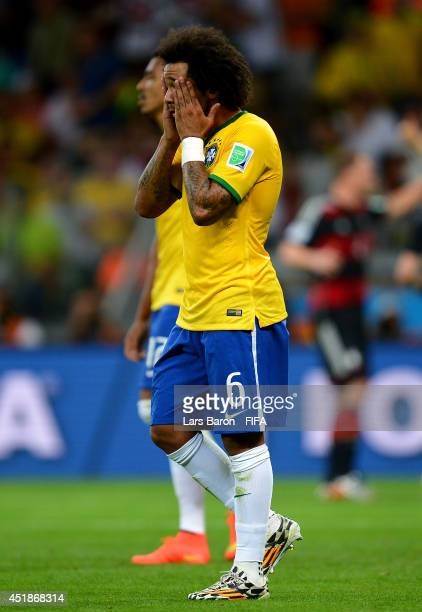 Marcelo of Brazil reacts after conceding the seventh goal to Germany during the 2014 FIFA World Cup Brazil Semi Final match between Brazil and...