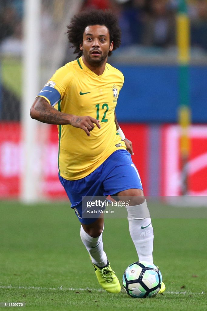 Marcelo of Brazil runs with the ball with of Ecuador during a match between Brazil and Ecuador as part of 2018 FIFA World Cup Russia Qualifier at Arena do Gremio on August 31, 2017 in Porto Alegre, Brazil.